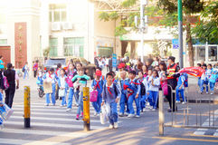 Primary school traffic intersection, parents volunteer to help maintain traffic safety order Royalty Free Stock Photography