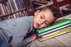 Primary schoolboy fallen asleep on books Royalty Free Stock Photo