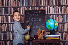 Primary schoolboy with a magnifying glass Royalty Free Stock Photography