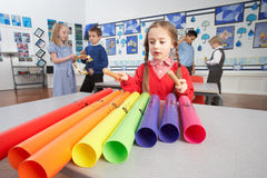 Primary Schoolchildren Having Music Lesson. Group Of Primary Schoolchildren Having Music Lesson In Classroom stock photo