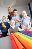 Primary Schoolchildren And Teacher Having A Lesson Stock Photos