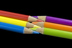 6 Primary and Secondary Coloured Pencils. Three primary coloured pencils facing three secondary coloured pencils with a dark black background royalty free stock image