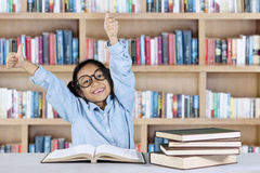 Primary student showing ok gesture in library Stock Images