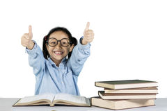 Primary student shows ok gesture with books Royalty Free Stock Photography