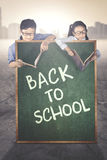Primary students behind text of back to school Royalty Free Stock Photo