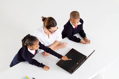 Primary teacher and students Royalty Free Stock Photos