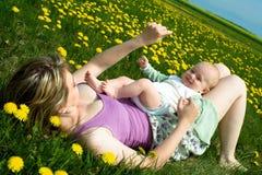 Primavera con el bebé Foto de archivo libre de regalías