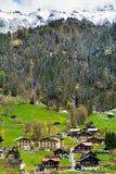 Primavera ed inverno in montagna delle alpi, regione di Jungfrau, Svizzera Fotografie Stock Libere da Diritti