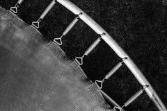 Primaveras atadas al marco del trampol?n foto de archivo libre de regalías