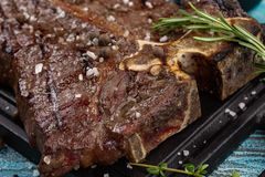 Prime Black Angus Ribeye steak. Medium Rare degree of steak doneness royalty free stock photography