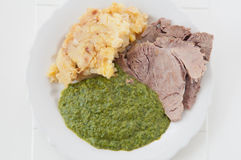 Prime boiled beef with spinach and potatoes Stock Image