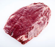 Prime cut of raw matured beef flank steak. Trimmed of fat ready for grilling or roasting isolated on white royalty free stock photography