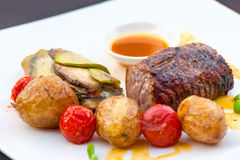 Prime grilled juicy beef steak with roasted vegetables Stock Photo