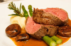 Prime Rib with Asparagus and Mushrooms Royalty Free Stock Photos