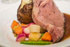 Prime Rib with Baked Potato and Mixed Vegetables Stock Photos