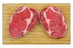Prime Rib Eye steak on a wooden cutting board Stock Photo