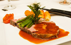 Prime Rib with Gravy and Rosemary Royalty Free Stock Images