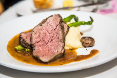 Prime Rib on Mashed Potatoes with Asparagus Stock Image