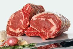 Prime rib roast. Prime rib raw beef roast in the kitchen Stock Photo