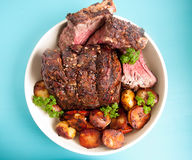 Prime rib roast with seasonal vegetables Royalty Free Stock Images