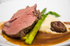 Prime Rib with Stalk of Asparagus Royalty Free Stock Photos