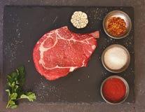 Prime rib steak on dark surface Royalty Free Stock Photos