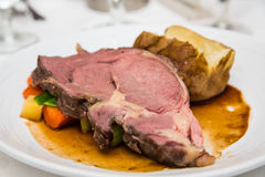 Prime Rib with Vegetables and Baked Potato Stock Photography