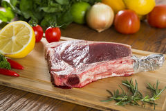Prime ribs raw on the board Stock Photos