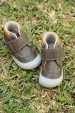 Prime scarpe del bambino Fotografia Stock