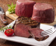 Prime steak cuts. Grilled and raw fillet cuts of meat Stock Photography