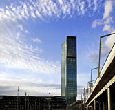 Prime Tower Skyscraper Zurich in blue sky and clouds. The tallest building in Switzerland located in the industrial area of the city of Zurich Stock Photo