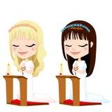 Primeiras meninas da oração do comunhão Fotos de Stock Royalty Free