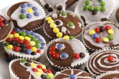 Primeiros queques do chocolate Imagem de Stock