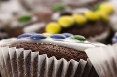 Primeiros queques do chocolate Fotografia de Stock