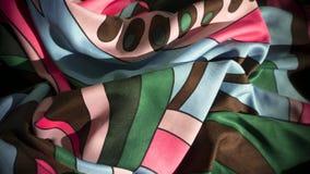 Primer colorido de la tela con textura de la materia textil imagen de archivo