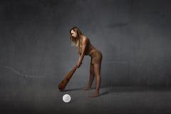 Primer concepto prehistórico del golfista imagenes de archivo