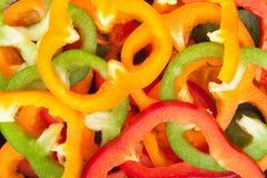 Paprikas cortados coloridos Fotos de archivo libres de regalías