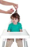 Primer corte de pelo del bebé imagen de archivo