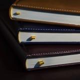 Primer de algunos cuadernos coloreados de los libros, diarios Imagen de archivo