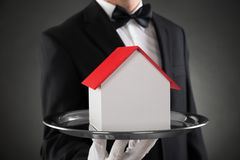 Primer de Butler With House Model Imagen de archivo