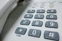 Primer de escritorio blanco del teléfono Foto de archivo libre de regalías