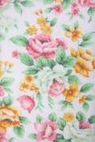 Primer de flores en fondo del modelo de la tela de la toalla Imagen de archivo