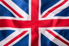 Primer de la bandera de Union Jack Bandera británica Bandera de británicos Union Jack que sopla en el viento Imagenes de archivo