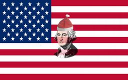 Primer de la bandera de los Estados Unidos de América con el retrato George Washington en sombrero rojo de la Navidad de Papá Noe foto de archivo libre de regalías