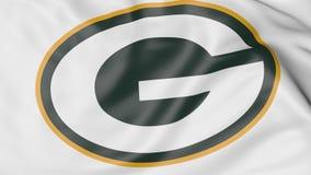 Primer de la bandera que agita con el logotipo americano del equipo de fútbol del NFL de los Green Bay Packers, representación 3D Imagen de archivo