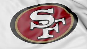 Primer de la bandera que agita con el logotipo americano del equipo de fútbol del NFL de los San Francisco 49ers, representación  ilustración del vector