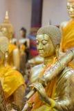 Primer de la cara y de las manos de la imagen del ` s de Buda Imagen de archivo libre de regalías
