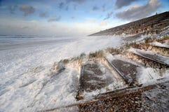 Primer de la espuma durante tormenta del invierno Fotografía de archivo