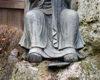 Primer de la estatua de Buda en el jardín japonés Fotos de archivo libres de regalías