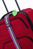 Etiqueta y correa del equipaje en la maleta Imagen de archivo